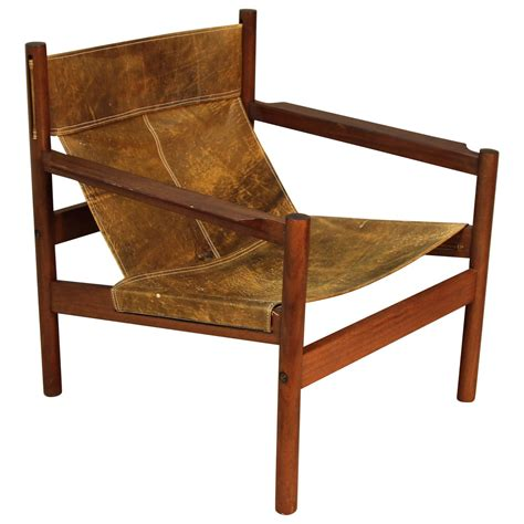Slingback Chairs by Michel Arnoult Distressed Leather Sling Back Chair At 1stdibs