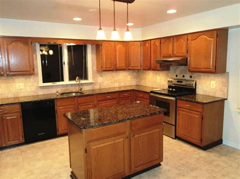oak cabinets  black appliances kitchen color ideas