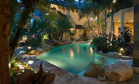 relaxing  dramatic tropical pool designs home