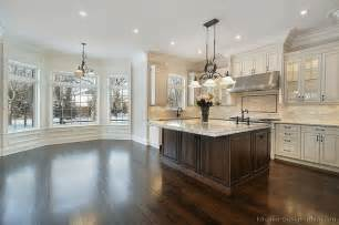 kitchen white dark floor traditional antique with alpine granite counters and wood island