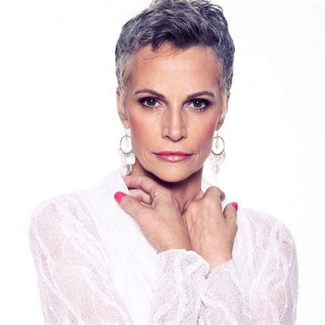 photo of striking gray hair striking beauty with cropped silver hair ageless beauty