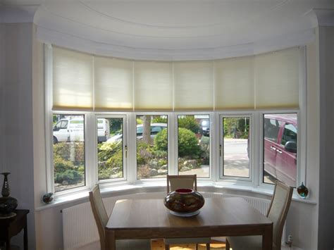 bow window shades top bottom up luxaflex duette blinds at a bow window