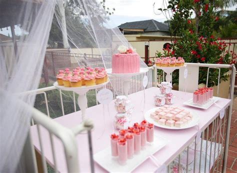 Baby Shower Catering Ideas by The Idea Of Using A Crib To Display The Food Pink Cupcakes And In Crib For Baby