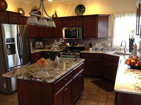 Modern Kitchen Cabinets Chicago by Delicatus White Granite Countertops