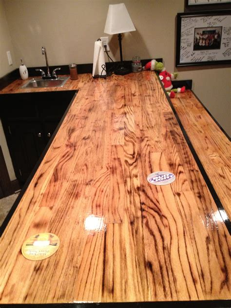 1 or 2 coats of stain on hardwood floors bar made out of oak hardwood flooring i torched the wood