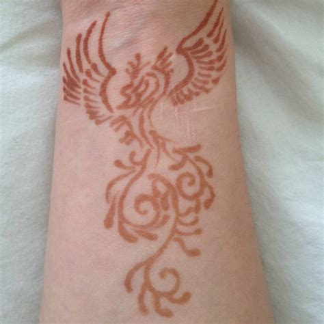 phoenix tattoo on wrist 8 phoenix wrist tattoos designs