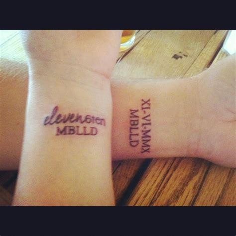 couple tattoos roman numerals our wedding date his in numerals and mine in text