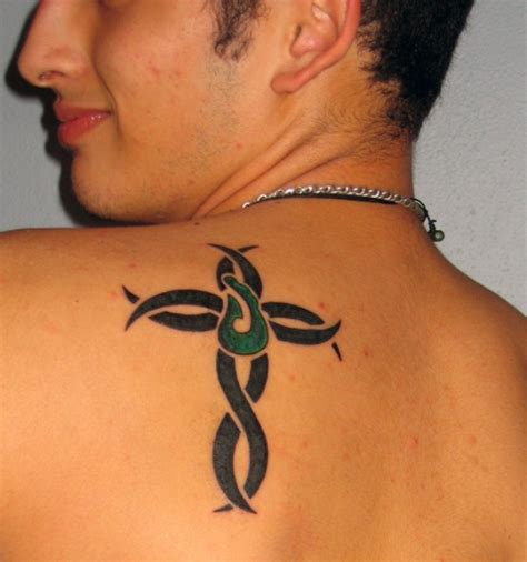 small back tattoos for guys cross tribal small tattoos for busbones