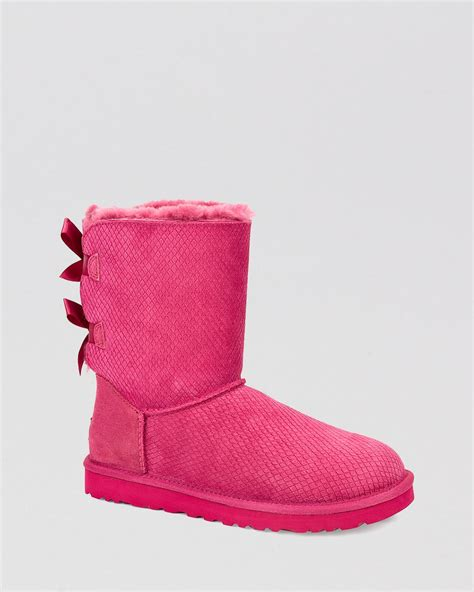 pink ugg boots with bows ugg 174 bow scales boots bailey in pink lyst