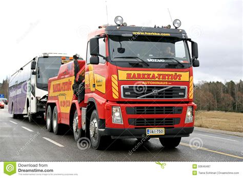 heavy duty volvo volvo fh13 heavy duty tow truck tows a bus editorial