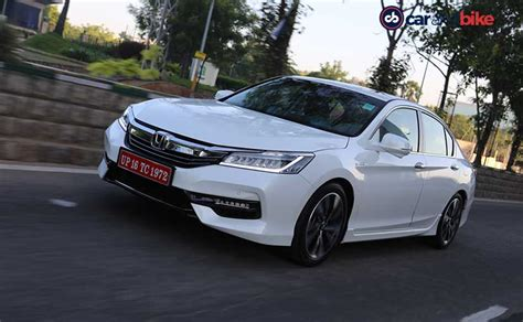 how the honda accord s innovative hybrid system works honda accord hybrid vs toyota camry hybrid specifications and features comparison ndtv carandbike