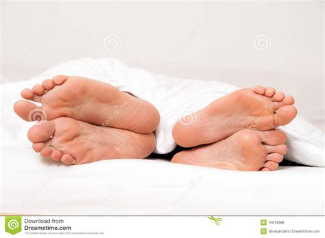 feet in bed feet of couple in bed separation and divorce royalty free stock photos image 15619388