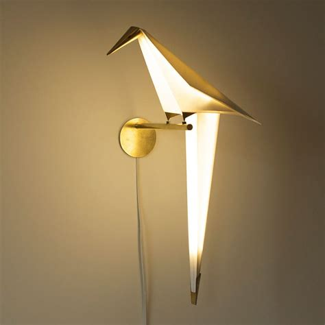Origami Lighting - bird shaped swinging origami light by umut yamac