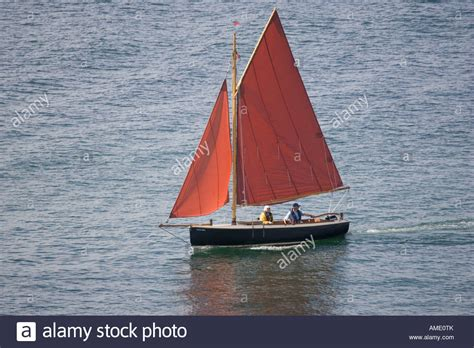boat fishing marks poole harbour small gaff rigged sailing boat with orange sails poole