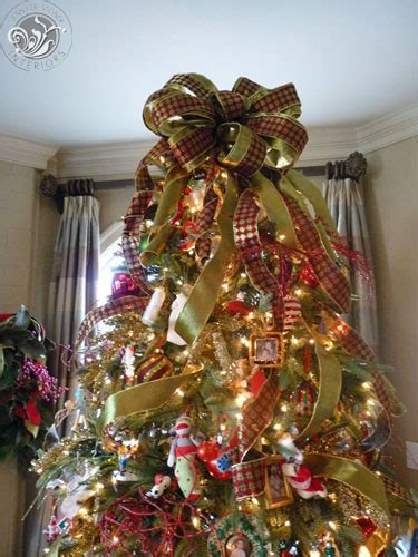 bow on christmas trees happy holidays draping ribbon on
