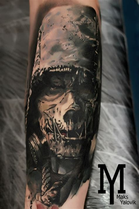 horror style colored arm tattoo of evil maniac with gas