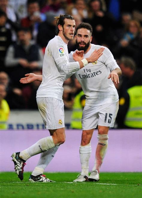 Madrid C 328 gareth bale of real madrid celebrates with team mate daniel carvajal as he scores their fourth