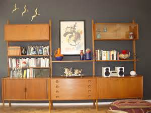mid century modern teak shelving unit on and lava