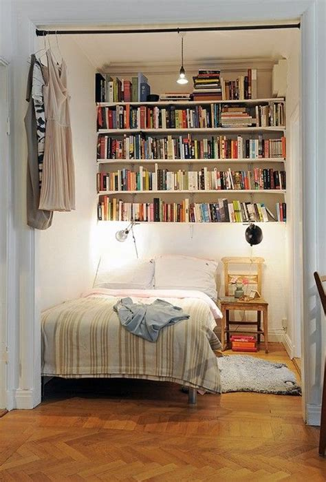 bedroom nook book shelf storage above bed hanging clothing and or