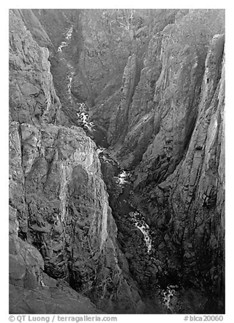 black and white picture/photo: view down steep rock walls