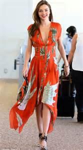 Kim Kardashian Vanity As Miranda Kerr Wears A Slashed To Navel Dress A Look