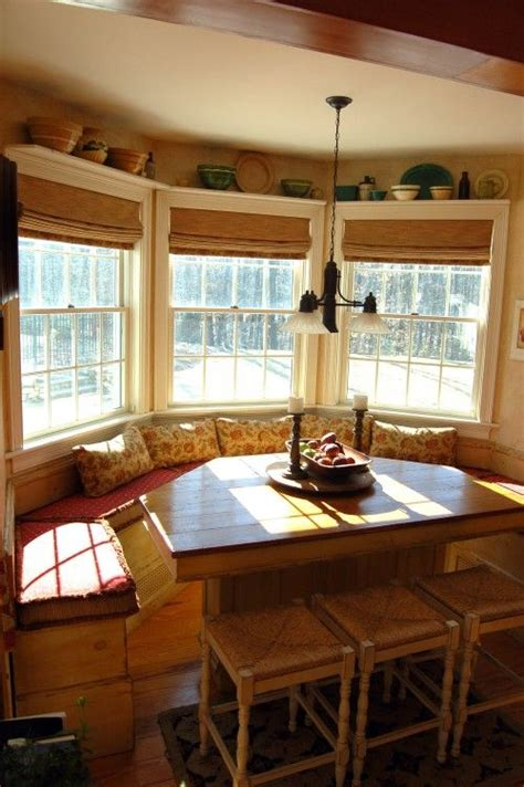 Table For Bay Window In Kitchen Bamboo Blinds And Shelves Above Windows Kitchen Ideas Traditional Creative And