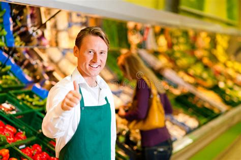 in supermarket as shop assistant stock photo image