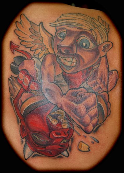angel tattoo memphis angel and devil fighting tattoo by memphis tattoonow