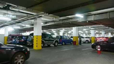 Underground Garage Russia by Car Goes Between Other Cars In Underground Parking Time