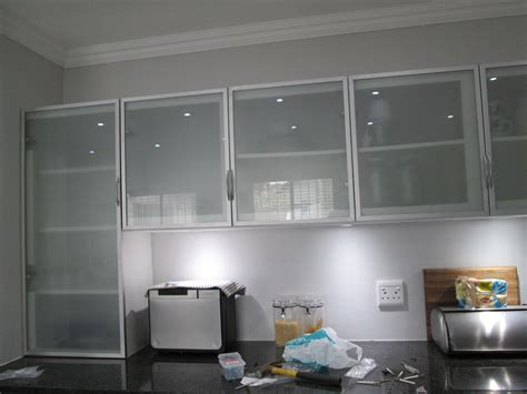Aluminum Frame Kitchen Cabinet Doors by This Kitchen Is Incorporating Aluminium Frame Cabinet