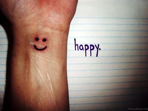 smiley tattoo designs 24 wonderful smile wrist tattoos