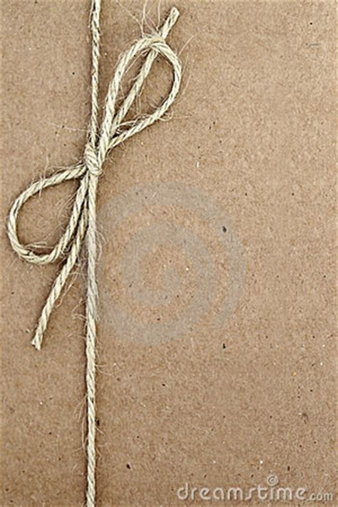 String On Paper - string bow on brown paper stock photo image 22999590