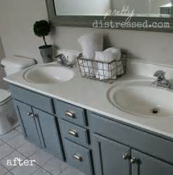 pretty distressed bathroom vanity makeover with paint