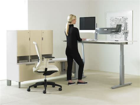 raise desk to standing height tested two standing desks to improve your workday inc