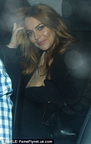 lindsay lohan steps out in plunging tuxedo dress and
