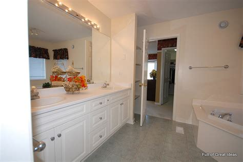 framing a builder grade bathroom mirror hometalk how to upgrade your builder grade mirror