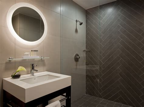 herringbone pattern accent wall check out this modern bathroom design love the