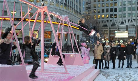 adult sized swing set evian proves canary wharf is swinging as part of live