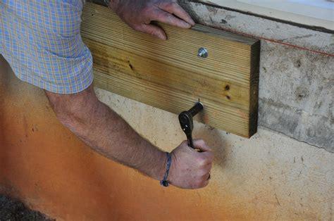 anchor into a concrete wall decks ledger board attachment to a solid concrete