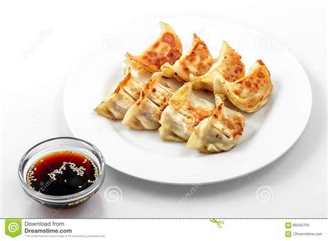 Dumpling Plate fried dumplings on plate and soy sauce royalty free stock
