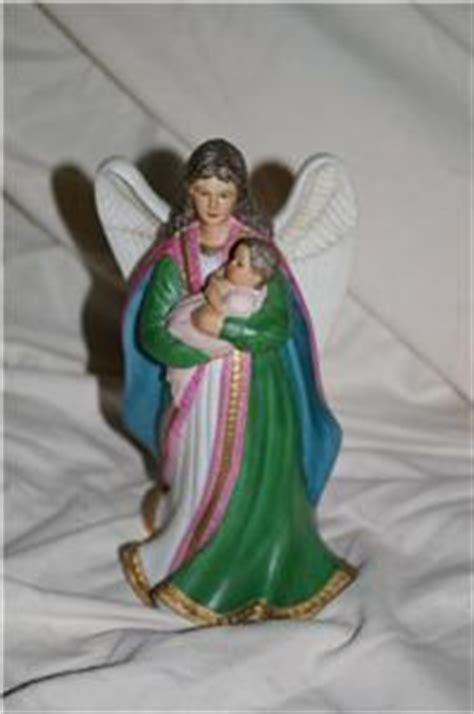 home interior angel figurines home interiors angel with baby figurine 1436 homco