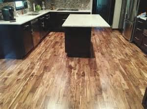 Asian walnut flooring in contrast to black furniture lauzon hardwood