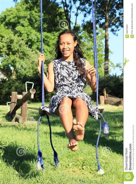 girl in swing girl on swing stock photo image 56810084