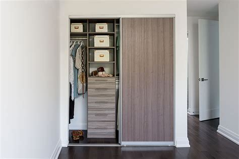 Closet Organizers With Doors Condo Closet With Melamine Sliding Door Transitional Closet