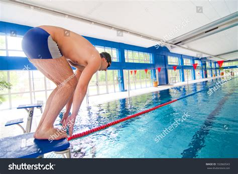 Get Ready In The Pool by Professional Swimmer Getting Ready To Jump In The Swimming