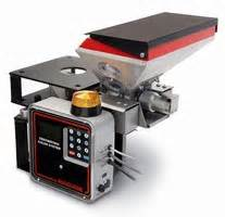 loading device meters additives into gravimetric feeder.