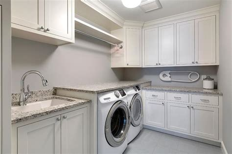 White Laundry Room Cabinets White Shaker Laundry Room Cabinets With Gray Granite Countertops Transitional Laundry Room