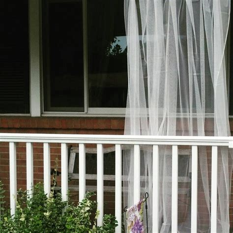 one white mosquito netting curtain for patio bedroom window