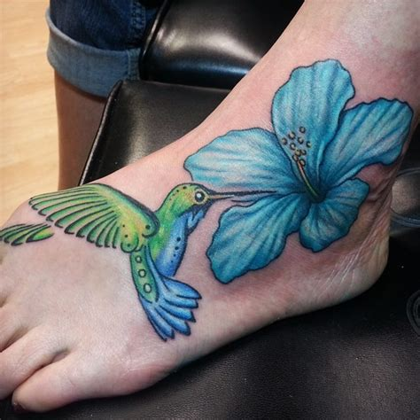 Hummingbird And Blue Hibiscus Flower Tattoo On Foot Blue Flower On Foot