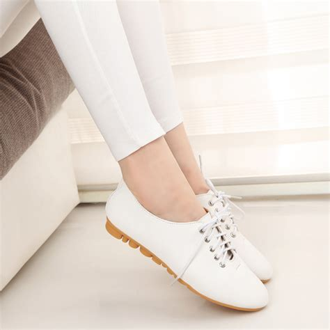 white flat shoes womens nike white boots flats provincial archives of